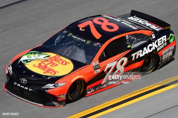 Martin Truex Jr driver of the Bass Pro Shops/TRACKER BOATS Toyota practices for the 59th Annual DAYTONA 500 at Daytona International Speedway on...