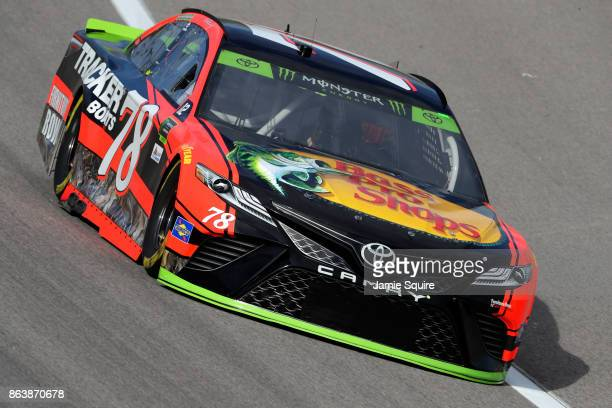 Martin Truex Jr driver of the Bass Pro Shops/Tracker Boats Toyota practices for the Monster Energy NASCAR Cup Series Hollywood Casino 400 at Kansas...