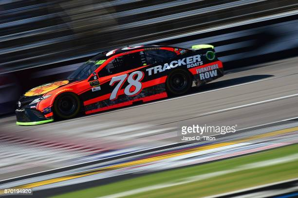 Martin Truex Jr driver of the Bass Pro Shops/Tracker Boats Toyota practices for the Monster Energy NASCAR Cup Series AAA Texas 500 at Texas Motor...