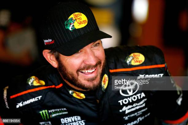 Martin Truex Jr driver of the Bass Pro Shops/TRACKER BOATS Toyota stands in the garage area during practice for the Monster Energy NASCAR Cup Series...
