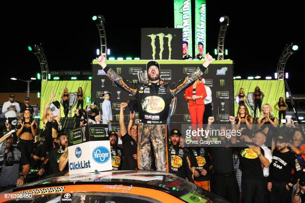 Martin Truex Jr., driver of the Bass Pro Shops/Tracker Boats Toyota, celebrates in Victory Lane after winning the Monster Energy NASCAR Cup Series...