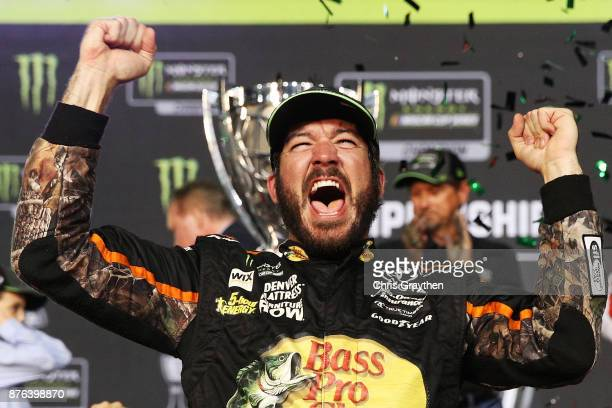 Martin Truex Jr driver of the Bass Pro Shops/Tracker Boats Toyota in Victory Lane after winning the Monster Energy NASCAR Cup Series Championship and...