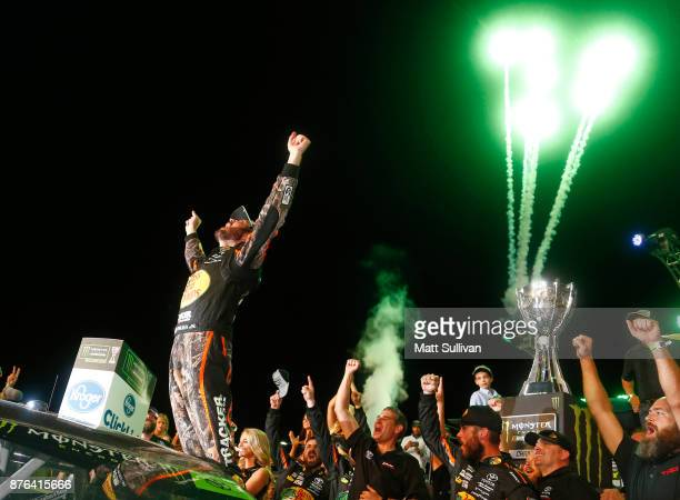 Martin Truex Jr driver of the Bass Pro Shops/Tracker Boats Toyota celebrates in Victory Lane after winning the Monster Energy NASCAR Cup Series...