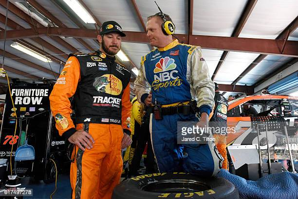 Martin Truex Jr driver of the Bass Pro Shops/TRACKER Boats Toyota is seen in the garage after an ontrack incident during the NASCAR Sprint Cup Series...