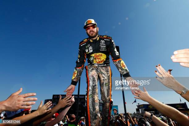 Martin Truex Jr driver of the Bass Pro Shops/Tracker Boats Toyota is introduced prior to the Monster Energy NASCAR Cup Series AAA Texas 500 at Texas...