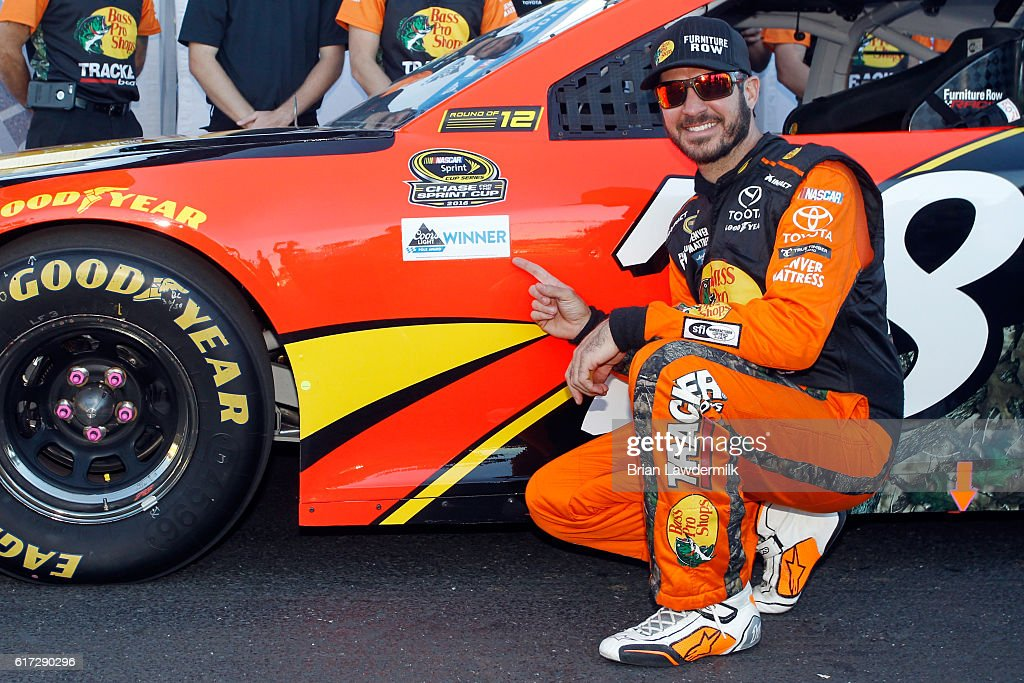 Martin Truex Jr, driver of the #78 Bass Pro Shops/TRACKER Boats Toyota, poses with the Coors Light Pole Award after qualifying for the pole position for the NNASCAR Sprint Cup Series Hellmann's 500 at Talladega Superspeedway on October 22, 2016 in Talladega, Alabama.