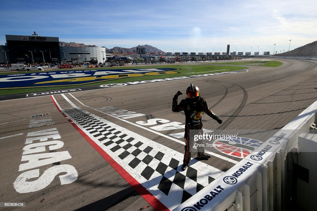 Martin Truex Jr., driver of the #78 Bass Pro Shops/TRACKER BOATS Toyota, celebrates with the checkered flag after winning the Monster Energy NASCAR Cup Series Kobalt 400 at Las Vegas Motor Speedway on March 12, 2017 in Las Vegas, Nevada.