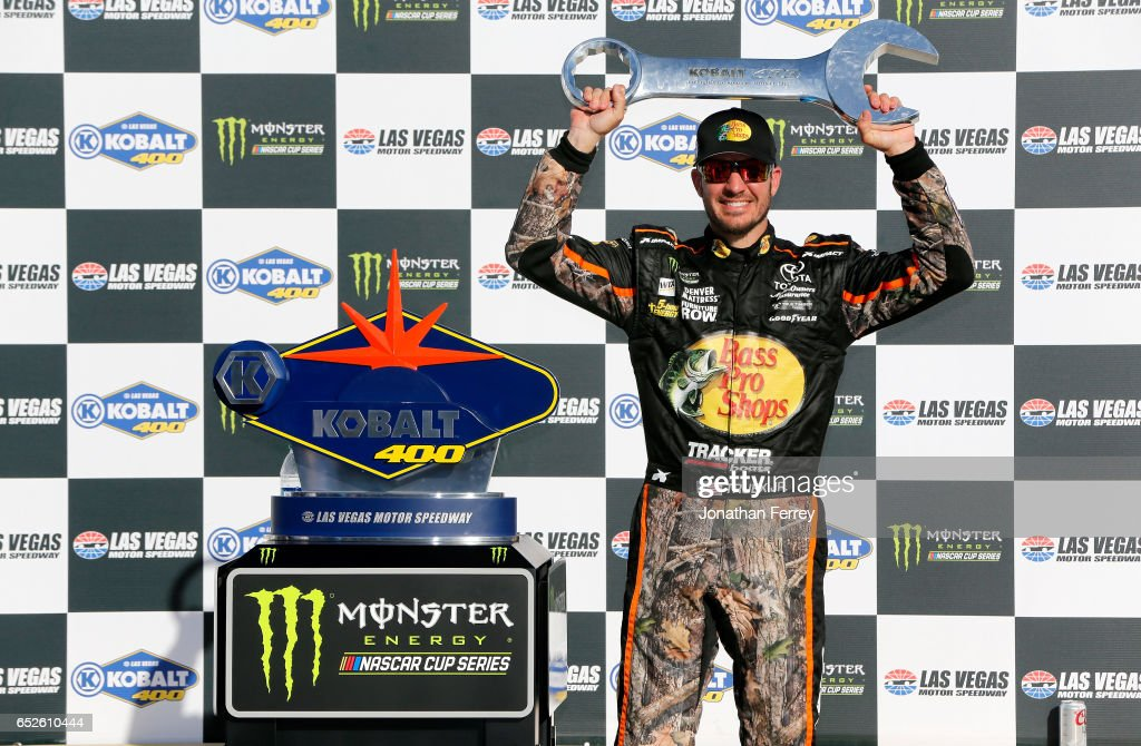 Martin Truex Jr., driver of the #78 Bass Pro Shops/TRACKER BOATS Toyota, poses with the trophy in Victory Lane after winning the Monster Energy NASCAR Cup Series Kobalt 400 at Las Vegas Motor Speedway on March 12, 2017 in Las Vegas, Nevada.