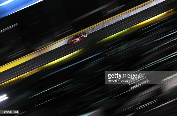 Martin Truex Jr driver of the Bass Pro Shops/Tracker Boats Toyota races during the Monster Energy NASCAR Cup Series CocaCola 600 at Charlotte Motor...