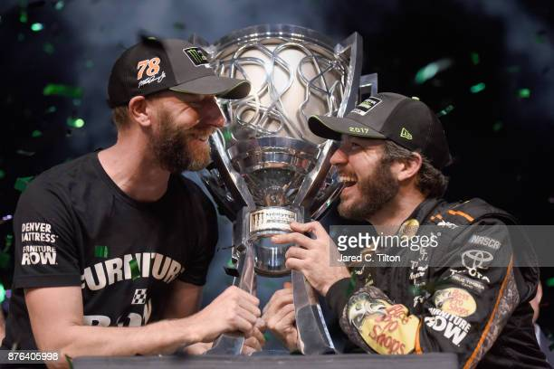 Martin Truex Jr driver of the Bass Pro Shops/Tracker Boats Toyota celebrates with crew chief Cole Pearn and the trophy in Victory Lane after winning...