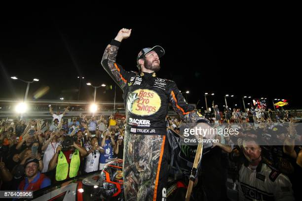 Martin Truex Jr., driver of the Bass Pro Shops/Tracker Boats Toyota, celebrates with teammates after winning the Monster Energy NASCAR Cup Series...