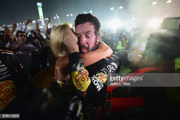 Martin Truex Jr driver of the Bass Pro Shops/Tracker Boats Toyota celebrates with girlfriend Sherry Pollex after he won the Monster Energy NASCAR Cup...