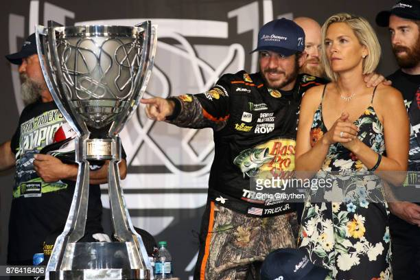 Martin Truex Jr driver of the Bass Pro Shops/Tracker Boats Toyota celebrates with girlfriend Sherry Pollex in Victory Lane after he won the Monster...