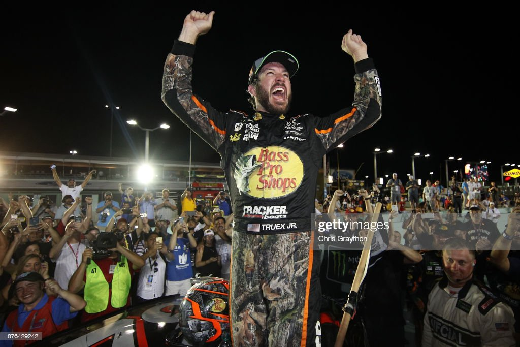 Martin Truex Jr., driver of the #78 Bass Pro Shops/Tracker Boats Toyota, celebrates after winning the Monster Energy NASCAR Cup Series Championship and the Monster Energy NASCAR Cup Series Championship Ford EcoBoost 400 at Homestead-Miami Speedway on November 19, 2017 in Homestead, Florida.