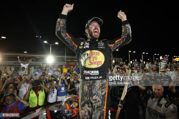 Martin Truex Jr., driver of the Bass Pro Shops/Tracker Boats Toyota, celebrates after winning the Monster Energy NASCAR Cup Series Championship and...