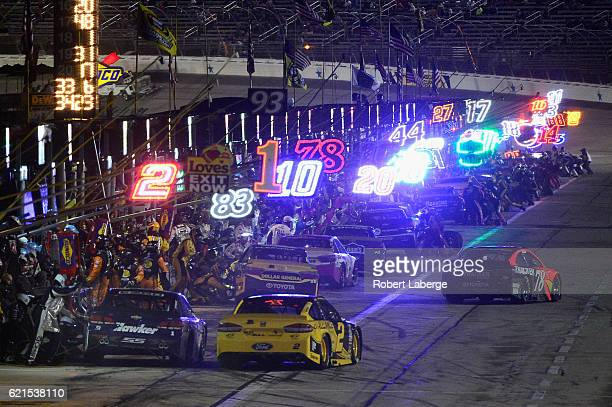 Martin Truex Jr driver of the Bass Pro Shops/TRACKER Boats Toyota exits pit road during the NASCAR Sprint Cup Series AAA Texas 500 at Texas Motor...