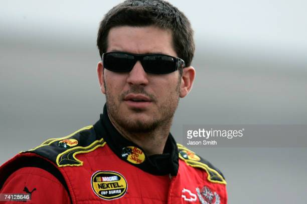Martin Truex Jr., driver of the Bass Pro Shops/Tracker Chevrolet, stands on pit road during qualifying for the NASCAR Nextel Cup Series Dodge Avenger...