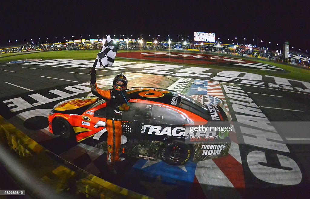Martin Truex Jr Driver Of The Bass Pro Shops/Tracker Toyota Celebrates With  The Checkered