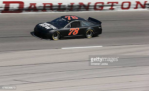 Martin Truex Jr driver of the Furniture Row Chevrolet during NASCAR testing at Darlington Raceway on June 10 2015 in Darlington South Carolina