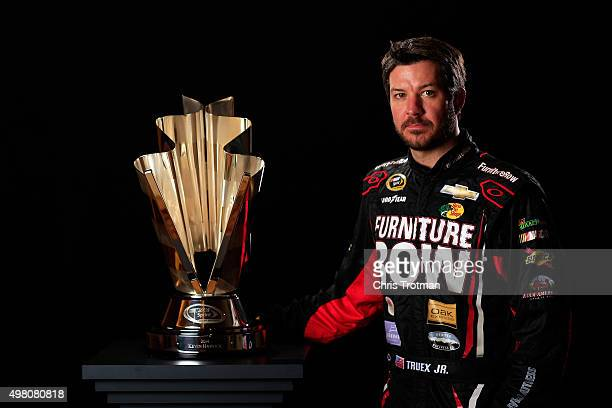 Martin Truex Jr driver of the Furniture Row Chevrolet poses for a photo with the NASCAR Sprint Cup Trophy during the NASCAR Sprint Cup Championship 4...