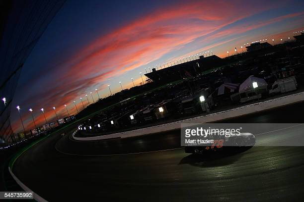 Martin Truex Jr driver of the Furniture Row Toyota leads a pack of cars during the NASCAR Sprint Cup Series Quaker State 400 at Kentucky Speedway on...