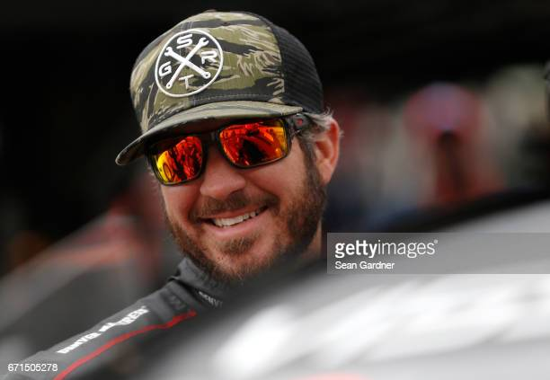 Martin Truex Jr driver of the Furniture Row/Denver Mattress Toyota stands by his car during practice for the Monster Energy NASCAR Cup Series Food...