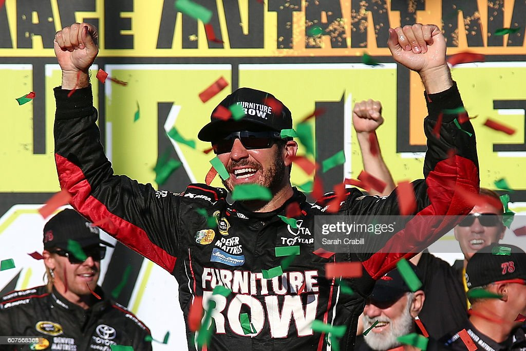 Martin Truex Jr, driver of the #78 Furniture Row/Denver Mattress Toyota, celebrates in Victory Lane after winning the NASCAR Sprint Cup Series Teenage Mutant Ninja Turtles 400 at Chicagoland Speedway on September 18, 2016 in Joliet, Illinois.