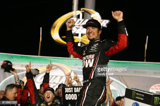Martin Truex Jr driver of the Furniture Row/Denver Mattress Toyota celebrates in Victory Lane after winning the Monster Energy NASCAR Cup Series...