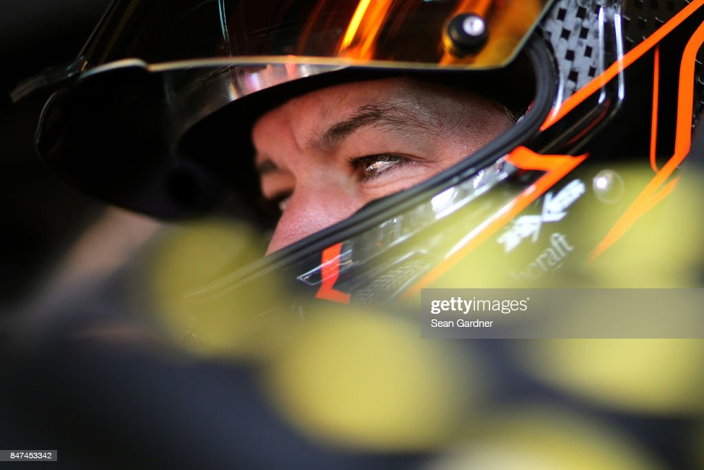 Martin Truex Jr., driver of the #78 Furniture Row/Denver Mattress Toyota, sits in his car during practice for the Monster Energy NASCAR Cup Series Tales of the Turtles 400 at Chicagoland Speedway on September 15, 2017 in Joliet, Illinois.