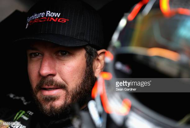 Martin Truex Jr driver of the Furniture Row/Denver Mattress Toyota sits in his car during practice for the Monster Energy NASCAR Cup Series Apache...