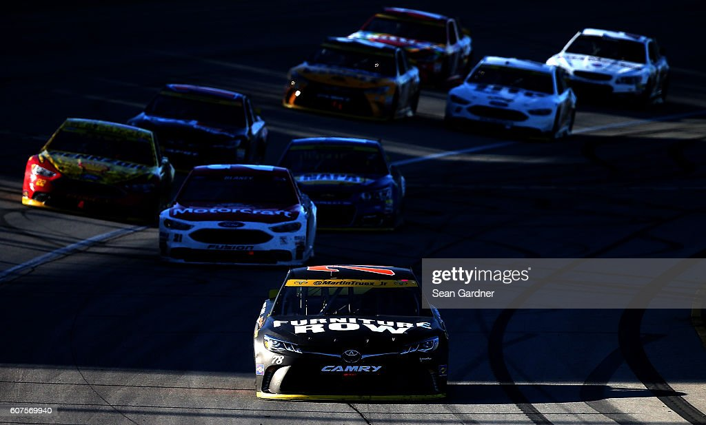 Martin Truex Jr, driver of the #78 Furniture Row/Denver Mattress Toyota, leads the field on the last lap during the NASCAR Sprint Cup Series Teenage Mutant Ninja Turtles 400 at Chicagoland Speedway on September 18, 2016 in Joliet, Illinois.