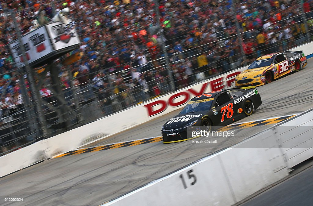 Martin Truex Jr., driver of the #78 Furniture Row/Denver Mattress Toyota, takes the checkered flag to win the NASCAR Sprint Cup Series Citizen Solider 400 at Dover International Speedway on October 2, 2016 in Dover, Delaware.
