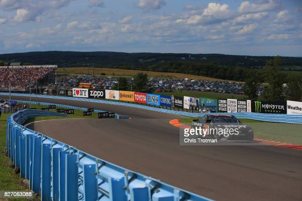 Martin Truex Jr driver of the Furniture Row/Denver Mattress Toyota drives during the Monster Energy NASCAR Cup Series I Love NY 355 at The Glen at...