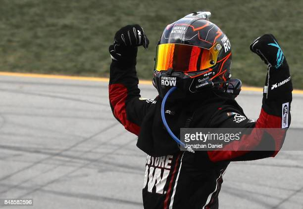 Martin Truex Jr driver of the Furniture Row/Denver Mattress Toyota celebrates winning the Monster Energy NASCAR Cup Series Tales of the Turtles 400...