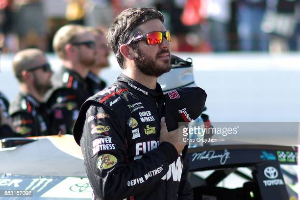 Martin Truex Jr driver of the Furniture Row/Denver Mattress Toyota stands during the national anthem prior to the Monster Energy NASCAR Cup Series...
