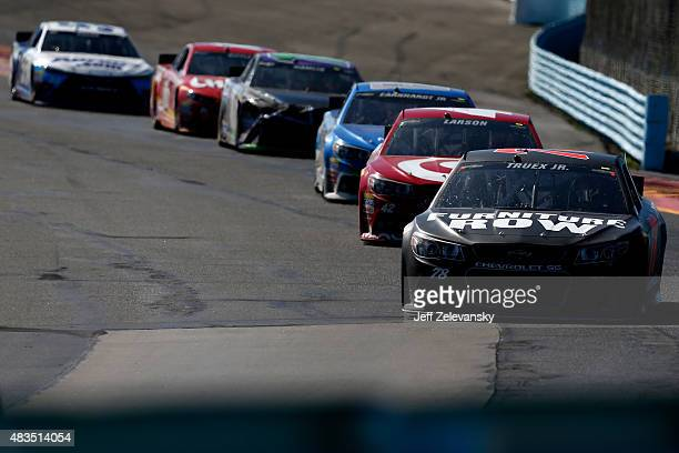 Martin Truex Jr driver of the Furniture Row/Visser Precision Chevrolet leads a pack of cars during the NASCAR Sprint Cup Series CheezIt 355 at the...