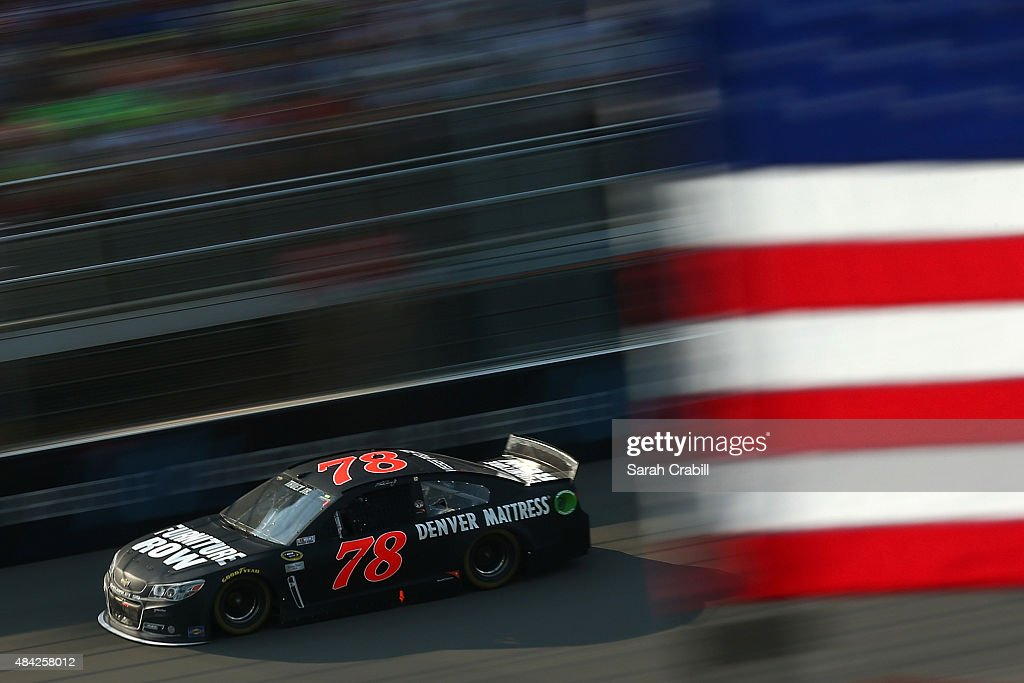 Martin Truex Jr., driver of the #78 Furniture Row/Visser Precision Chevrolet, races during the NASCAR Sprint Cup Series Pure Michigan 400 at Michigan International Speedway on August 16, 2015 in Brooklyn, Michigan.
