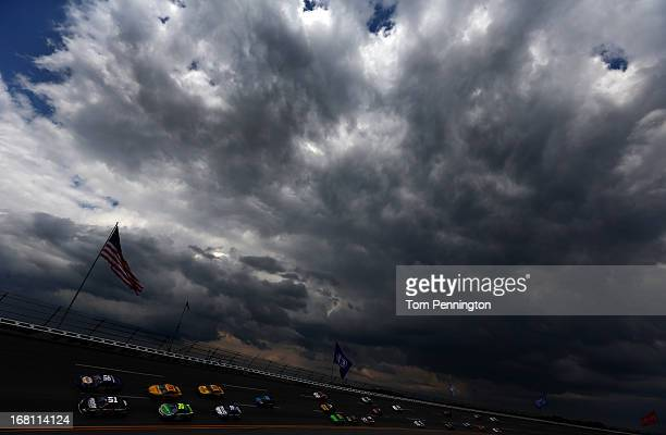 Martin Truex Jr driver of the NAPA Auto Parts Toyota and Regan Smith driver of the Hendrickscom Chevrolet lead the field during the NASCAR Sprint Cup...