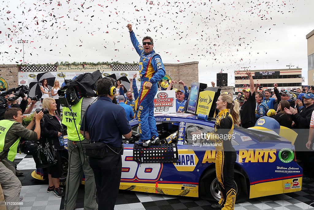 Martin Truex Jr., driver of the #56 NAPA Auto Parts Toyota, celebrates in victory lane after winning the NASCAR Sprint Cup Series Toyota/Save Mart 350 at Sonoma Raceway on June 23, 2013 in Sonoma, California.