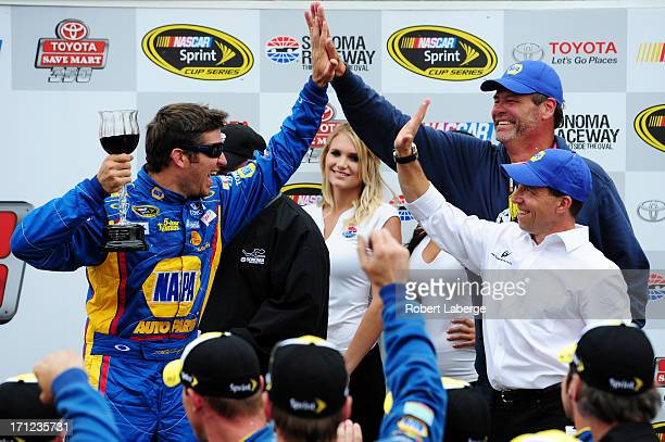 Martin Truex Jr driver of the NAPA Auto Parts Toyota celebrates in Victory Lane with team owners Michael Waltrip and Rob Kauffman after winning the...