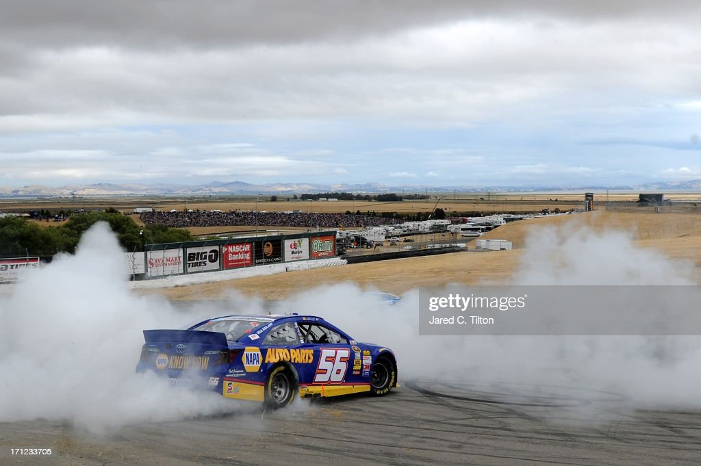 Martin Truex Jr., driver of the #56 NAPA Auto Parts Toyota, celebrates with a burnout after winning the NASCAR Sprint Cup Series Toyota/Save Mart 350 at Sonoma Raceway on June 23, 2013 in Sonoma, California.