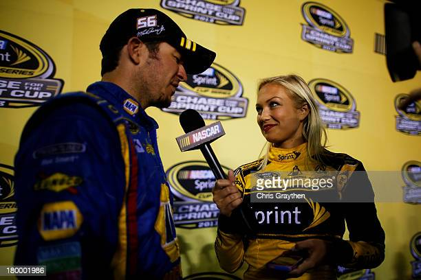 Martin Truex Jr driver of the NAPA Auto Parts Toyota is interviewed by Miss Sprint Cup Brooke Werner after qualifying for the Chase for the Sprint...