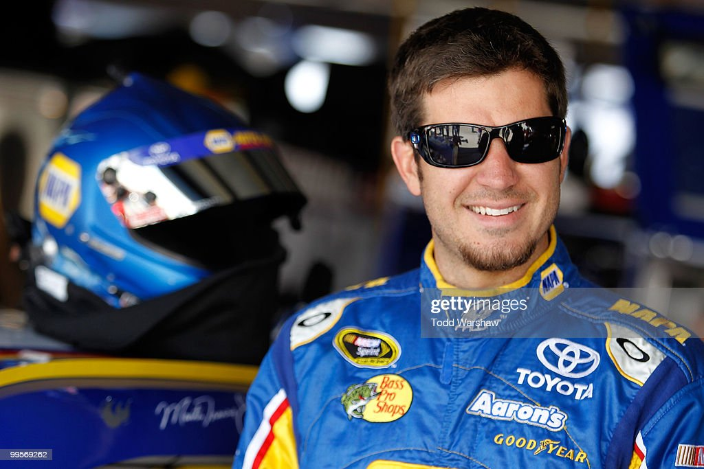 Martin Truex Jr., driver of the #56 NAPA Auto Parts Toyota, stands in the garage prior to practice for the NASCAR Sprint Cup Series Autism Speaks 400 at Dover International Speedway on May 15, 2010 in Dover, Delaware.