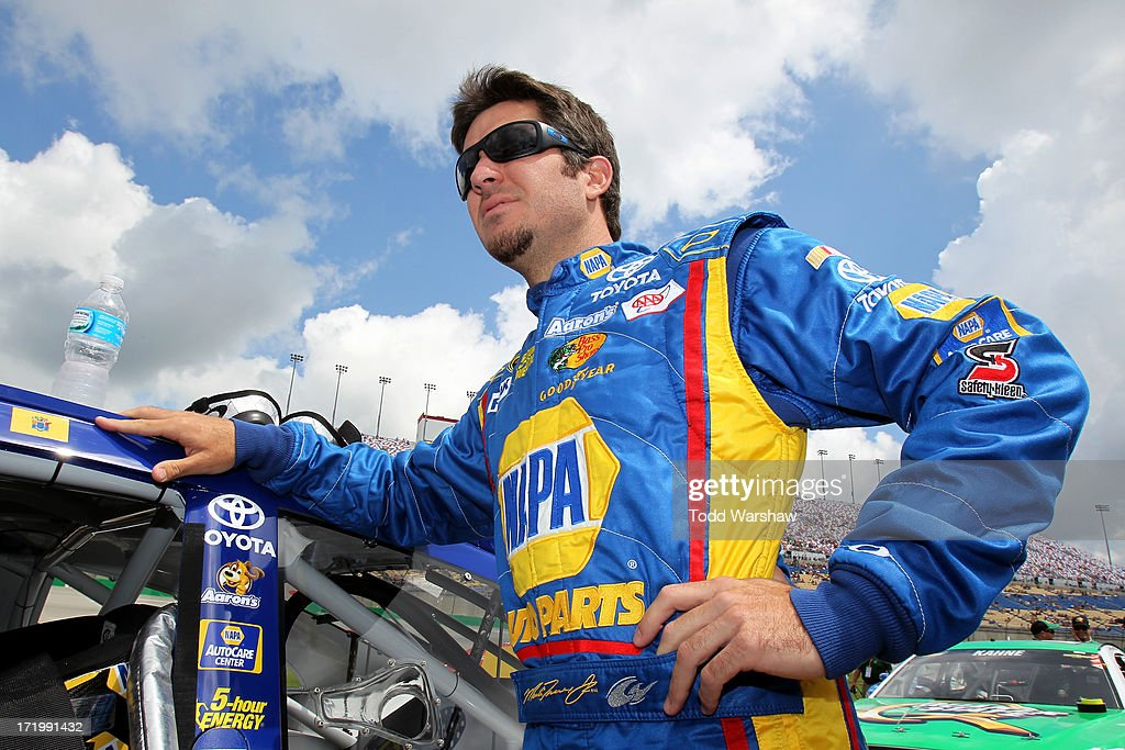 Martin Truex Jr., driver of the #56 NAPA Auto Parts Toyota, stands on the grid before the NASCAR Sprint Cup Series Quaker State 400 at Kentucky Speedway on June 30, 2013 in Sparta, Kentucky.