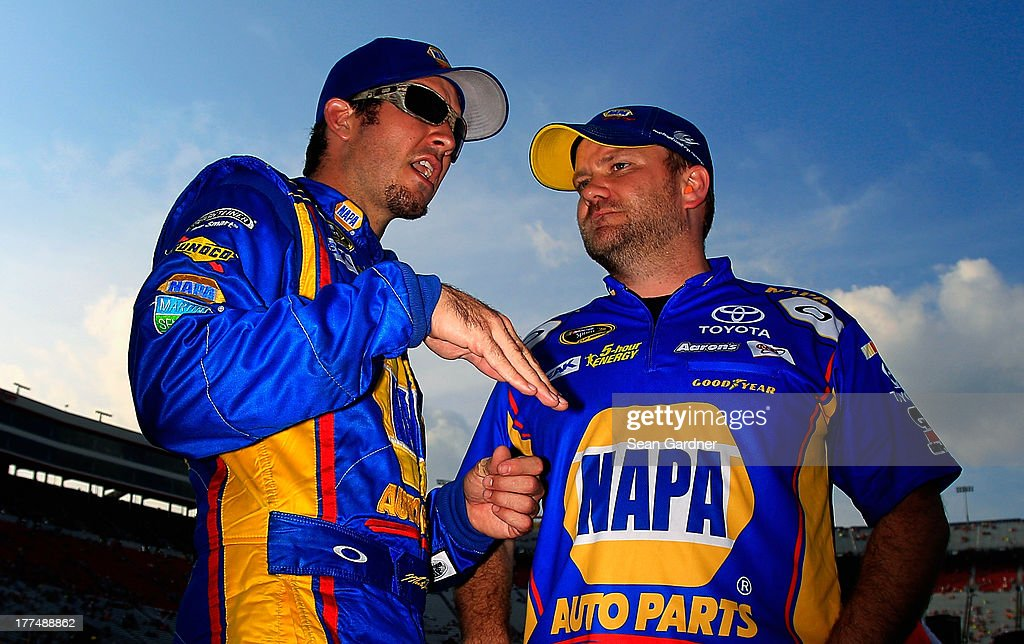 Martin Truex Jr., driver of the #56 NAPA Auto Parts Toyota, talks with crew chief Chad Johnston during qualifying for the NASCAR Sprint Cup Series IRWIN Tools Night Race at Bristol Motor Speedway on August 23, 2013 in Bristol, Tennessee.
