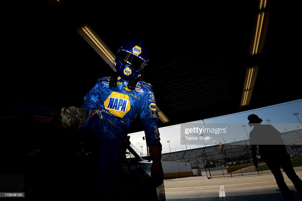 Martin Truex Jr., driver of the #56 NAPA Batteries Toyota, gets out of his car following qualifying for the NASCAR Sprint Cup Series Coke Zero 400 at Daytona International Speedway on July 5, 2013 in Daytona Beach, Florida.