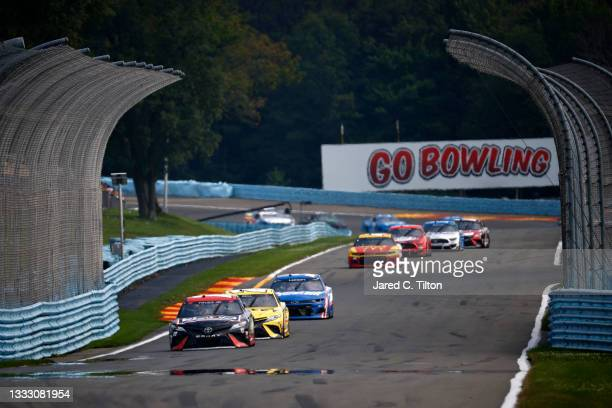 Martin Truex Jr., driver of the Reser's Fine Foods Toyota, leads the field during the NASCAR Cup Series Go Bowling at The Glen at Watkins Glen...