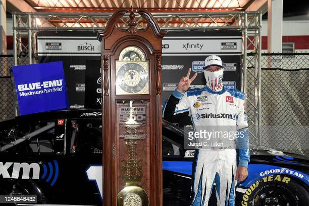 Martin Truex Jr., driver of the SiriusXM Toyota, celebrates in Victory Lane after winning the NASCAR Cup Series Blue-Emu Maximum Pain Relief 500 at...