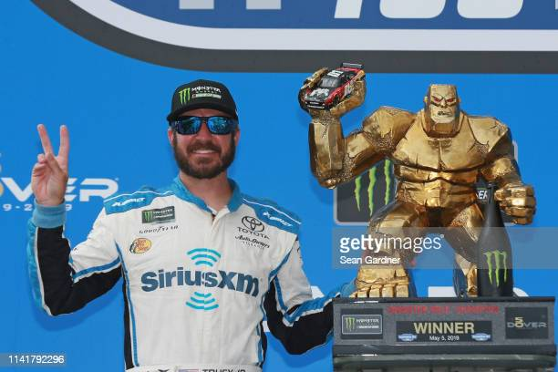 Martin Truex Jr driver of the SiriusXM Toyota poses with the trophy after winning the Monster Energy NASCAR Cup Series Gander RV 400 at Dover...