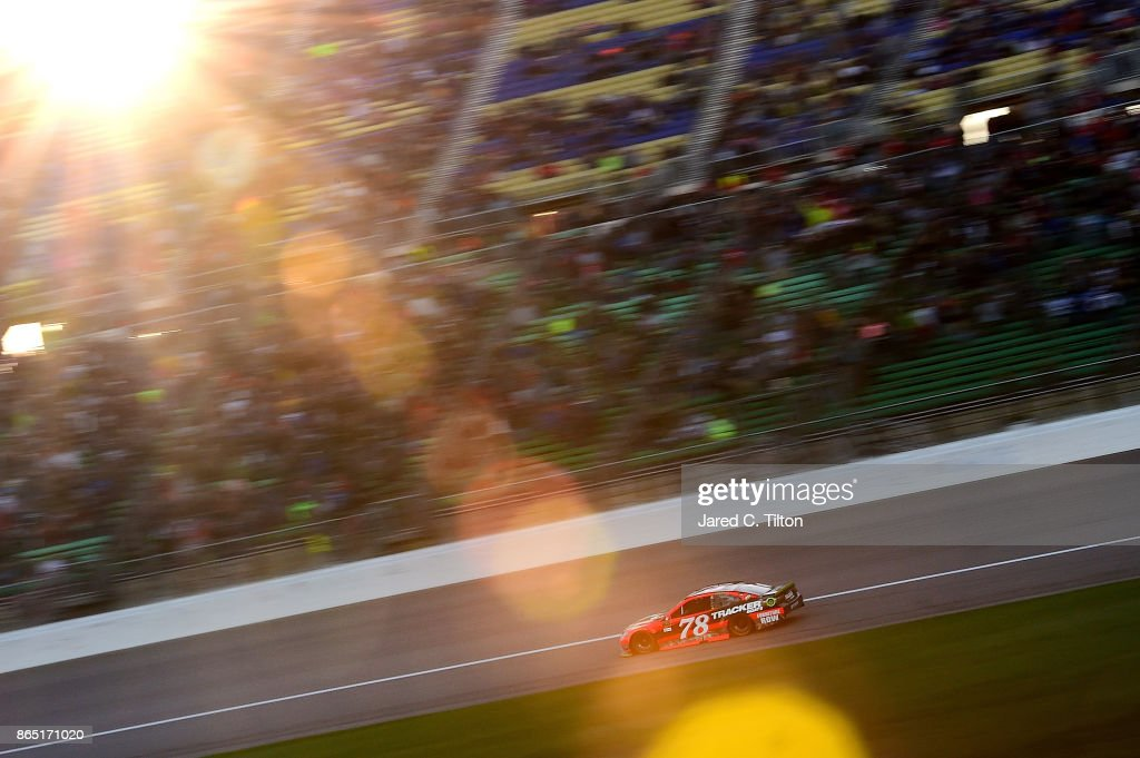 Martin Truex Jr. drives the #78 Bass Pro Shops/Tracker Boats Toyota during the Monster Energy NASCAR Cup Series Hollywood Casino 400 at Kansas Speedway on October 22, 2017 in Kansas City, Kansas.